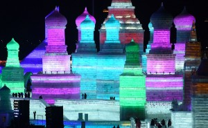 TOPSHOT - Visitors walk through the China Ice and Snow World during the Harbin International Ice and Snow Festival in Harbin, northeast China's Heilongjiang province on January 5, 2016. Over one million visitors are expected to attend the spectacular Harbin Ice Festival, where buildings of ice are bathed in ethereal lights and international ice sculptors compete for honours. AFP PHOTO / WANG ZHAO / AFP / WANG ZHAO (Photo credit should read WANG ZHAO/AFP/Getty Images)