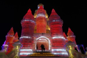 People visit ice sculptures illuminated by coloured lights on the opening day of the Harbin International Ice and Snow Festival in the northern city of Harbin, Heilongjiang province, China, January 5, 2016. REUTERS/Aly Song - RTX2143O