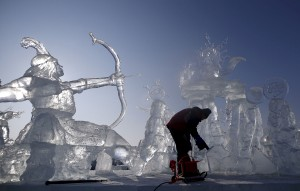 A worker polishes an ice sculpture ahead of the Harbin International Ice and Snow Festival in the northern city of Harbin, Heilongjiang province, January 4, 2016. REUTERS/Aly Song - RTX20XCL